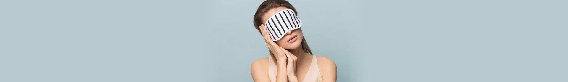 woman wearing sleeping mask